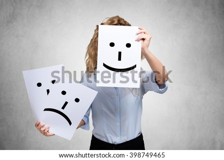Conceptual image of a woman changing her mood from bad to good - stock photo