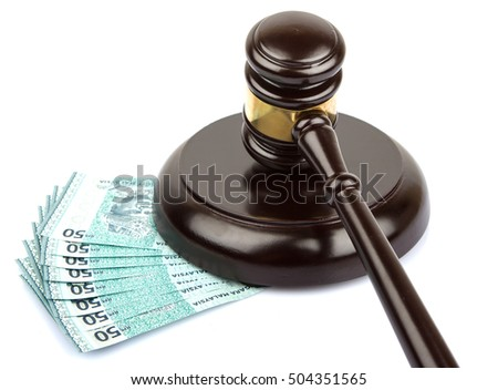 Conceptual image of a wooden gavel and Malaysian bank notes over white background