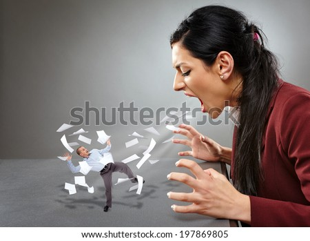Conceptual image of an angry lady boss yelling and blowing away an employee in a hurricane of paperwork - stock photo