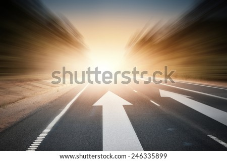 Conceptual image of asphalt road and direction arrow - stock photo