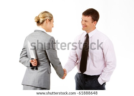 Conceptual image of business woman with knife doing agreement with businessman - stock photo