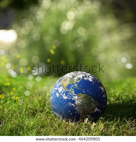 conceptual image of close up globe on landscape. Furnished NASA image used for this image.