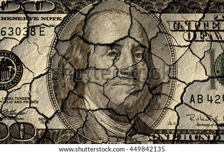 conceptual image of cracked dollar bill - stock photo