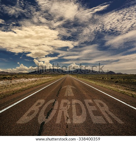Conceptual image of desert road with the word border and arrow