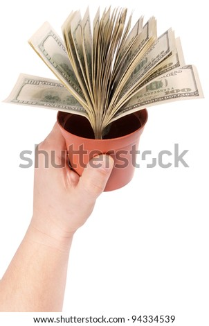 Conceptual image of dollars in a pot isolated on a white background.