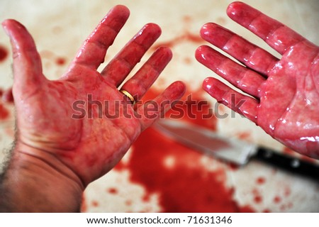 Conceptual image of hands of a married man with a wedding ring are covered in blood Concept photo of murder and crime - stock photo