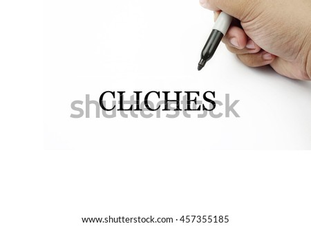 Conceptual image of handwriting CLICHES with the hand and pen isolated in white background.