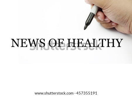 Conceptual image of handwriting NEWS OF HEALTHY with the hand and pen isolated in white background.
