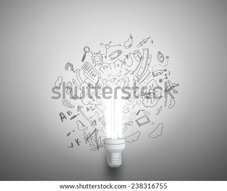 Conceptual image of light bulb and business sketches