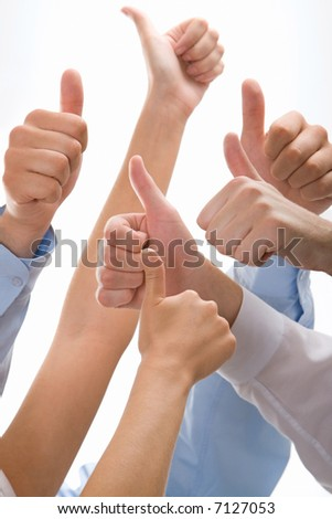 Conceptual image of success: thumbs up - stock photo