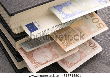 Conceptual image of the value of education, knowledge, or information. - stock photo