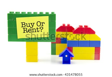 Conceptual image of two home icon made from plastic building blocks and signage with word BUY OR RENT isolated on white background - stock photo