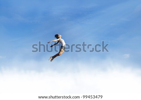 Conceptual image of Woman jumping over the clouds for freedom
