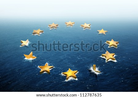 Conceptual image representing the stars of the European Union flag drifting and sinking in the ocean - stock photo