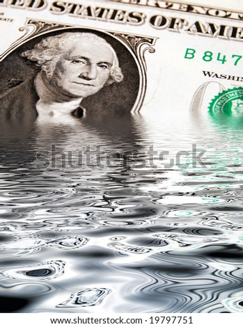 Conceptual image showing US dollar sinking in water - stock photo