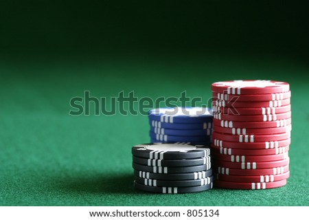 Conceptual image with a variety of uses in any area where the chips may be stacked against you. - stock photo