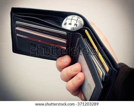 Conceptual image with gearshift speed marks in a wallet. - stock photo