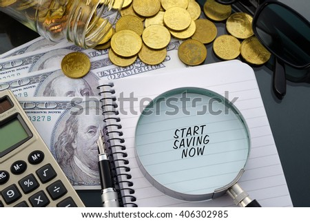 Conceptual image with hundred dollar bills, coins, calculator, notepad and magnifying glass with word Start Saving Now. - stock photo