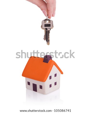 Conceptual image with small house and keys.Isolated on white - stock photo