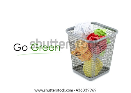 """conceptual image with word """"GO GREEN"""" over crumple paper in metal dustbin and isolated white background - stock photo"""