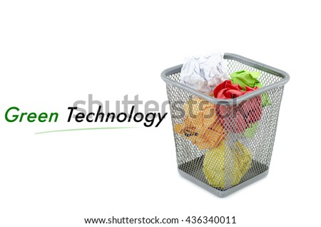 """conceptual image with word """" GREEN TECHNOLOGY"""" over crumple paper in metal dustbin and isolated white background - stock photo"""