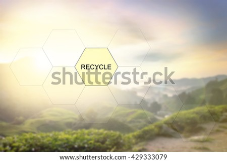 conceptual image with word RECYCLE over blurred nature image background of tea plantation - stock photo