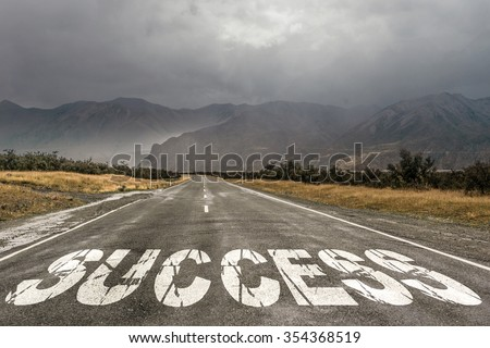 Conceptual image with word success on asphalt road - stock photo