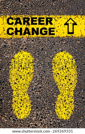 Conceptual image with yellow paint footsteps on the road in front of horizontal line over asphalt stone background. Message Career Change and arrow pointing upwards. Conceptual image - stock photo