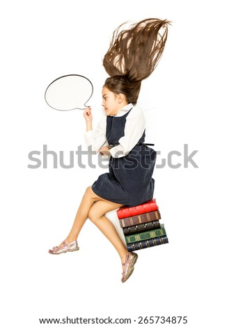 Conceptual isolated photo of cute thoughtful schoolgirl sitting on books - stock photo