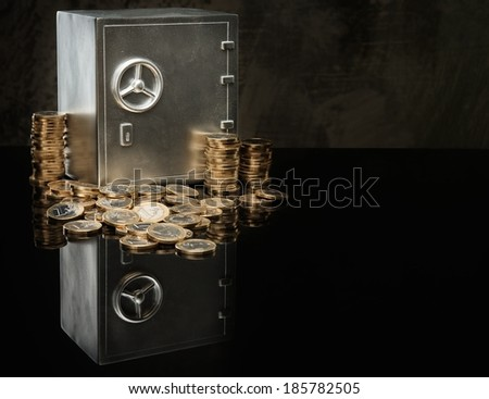 Conceptual little safe with euro coins - stock photo