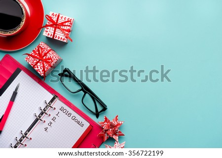 Conceptual,notebook on a table. open diary and pen with new year goals words - stock photo