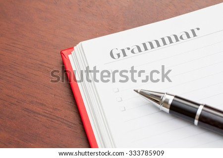 Conceptual,notebook on a wooden table. open diary and pen to record - stock photo