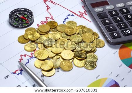 Conceptual of Gold Investment success with calculator, compas, ballpoint and graph on the background - stock photo