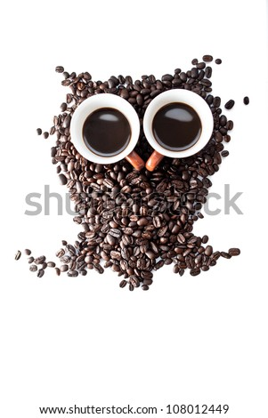 conceptual owl made with coffee beans and cups - stock photo