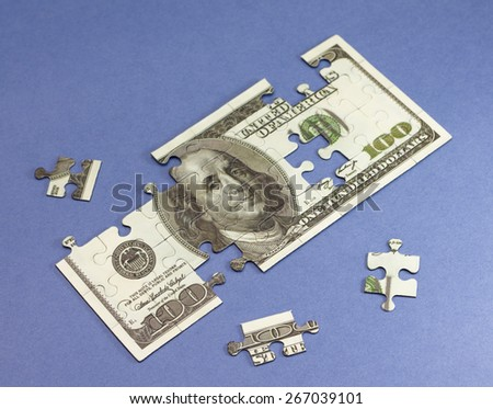 Conceptual photo. Build your own capital. On blue backdrop - stock photo
