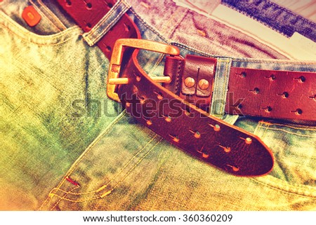 conceptual photo, clothes, vintage jeans and a belt - stock photo