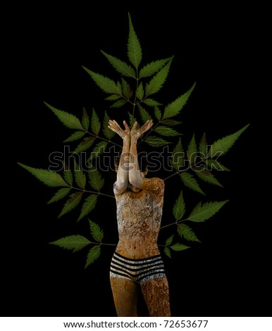 Conceptual photo montage of girl with bark skin growing branches with green leaves from her body, isolated on black - stock photo