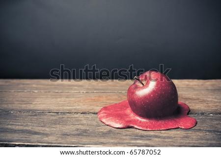 conceptual photo of a melting apple - stock photo