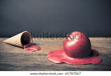 conceptual photo of a melting apple - stock photo
