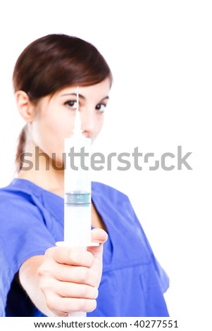 Conceptual Photo Of A Young Nurse Showing A Syringe