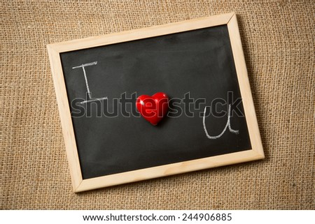 Conceptual photo of declaration of love written on black chalkboard - stock photo