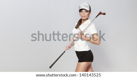 Conceptual photo of female beautiful and sexy golf player, studio shot. - stock photo
