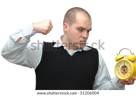 Conceptual photo of young man trying to destroy alarm clock - stock photo