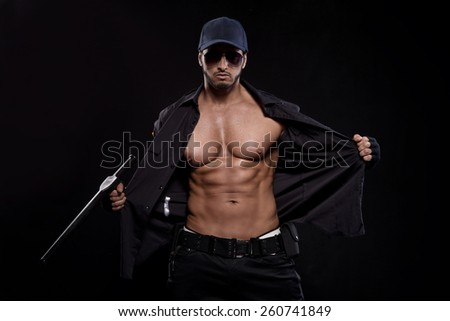 Conceptual photo of young, sexy and good looking police officer,   - stock photo