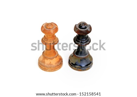 Conceptual photo with old chess pieces (black and white queens) - stock photo