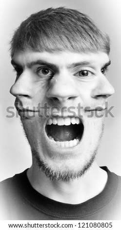Conceptual photograph of a guy with three faces, side ones looking in opposite direction and one in the center screaming or shouting.