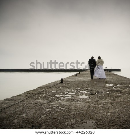 Conceptual photograph of a wonderful couple during wedding on the sea coast - stock photo