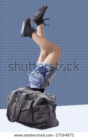 Conceptual picture. A young woman falling inside her bag. - stock photo