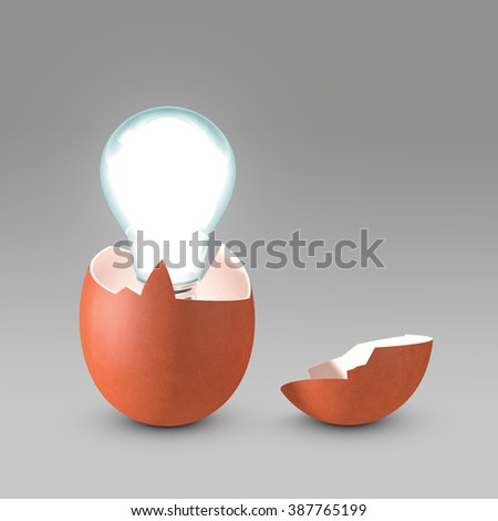Conceptual picture of a nascent idea. The light bulb is hatching from the eggshell like a newborn idea. Copy space available. - stock photo