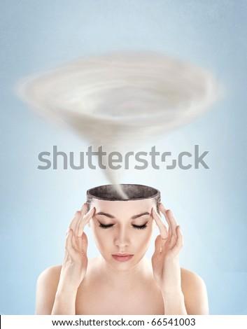 Conceptual picture - tornado in woman's head - stock photo